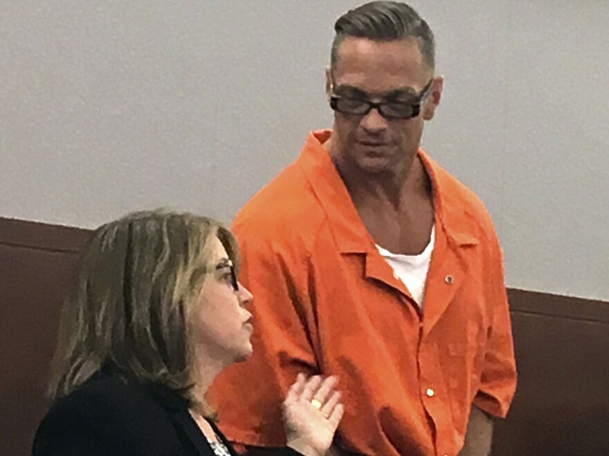 Nevada death row inmate Scott Raymond Dozier confers with public defender Lori Teiche in Clark County District Court in Las Vegas in August 2017.