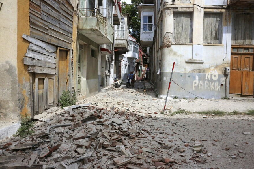Debris from a damaged building after an earthquake in the village of Plomari on the northeastern Greek island of Lesbos on Monday.