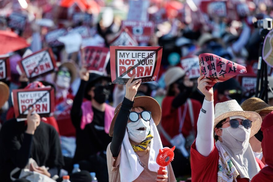 """Some 70,000 women in August gathered in central Seoul, holding signs saying, """"My life is not your porn."""" It was the fourth protest this year condemning the prevalence of hidden-camera crimes."""