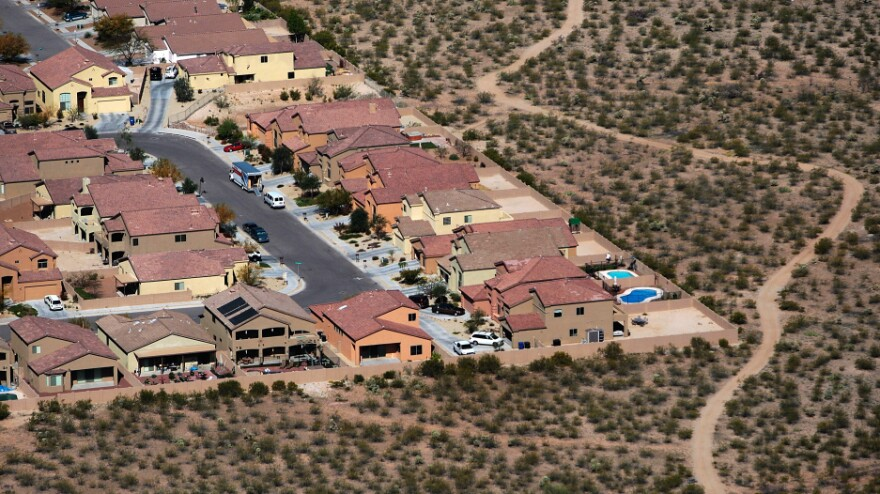 While some sections of Arizona's housing market have shown signs of recovery, potential homebuyers who are looking for affordable houses have been frustrated. This file photo from 2008 shows a subdivision extending into desert scrubland.