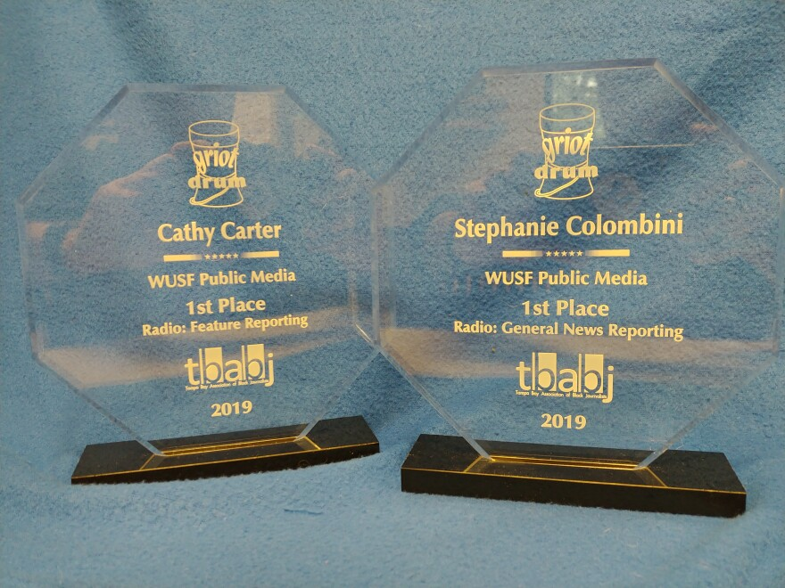 WUSF reporter Cathy Carter won the Best Feature Reporting Award while Stephanie Colombini won the Best General Reporting Award.