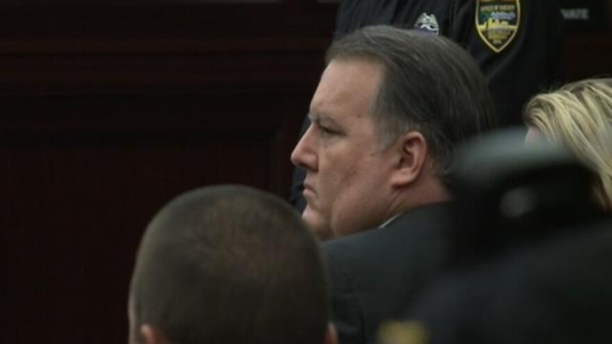 Michael Dunn listens as the jury delivers its verdict on October 1, 2014.