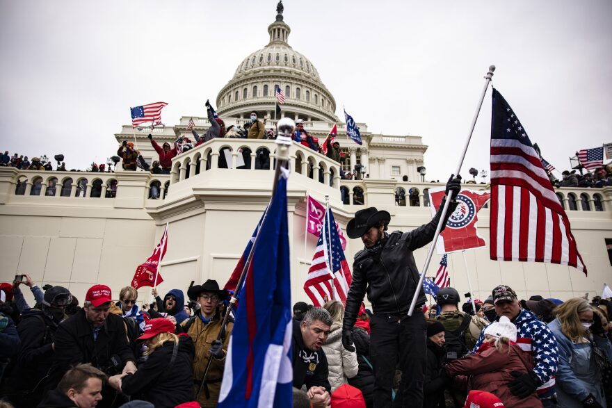 Pro-Trump supporters storm the U.S. Capitol following a rally with President Donald Trump on January 6, 2021 in Washington, DC. Trump supporters gathered in the nation's capital today to protest the ratification of President-elect Joe Biden's Electoral College victory over President Trump in the 2020 election. (Samuel Corum/Getty Images)