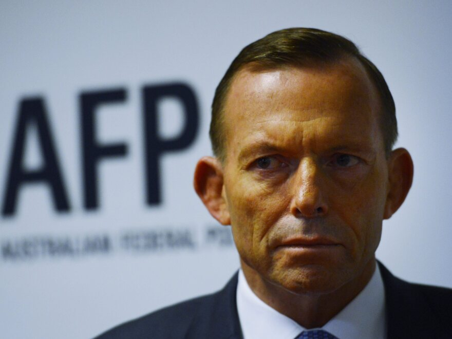 Australian Prime Minister Tony Abbott visits the Endeavour Hills police station in Melbourne, Australia, on Friday. Abbott has declined to refute claims that his government paid smugglers to turn back would-be asylum seekers.