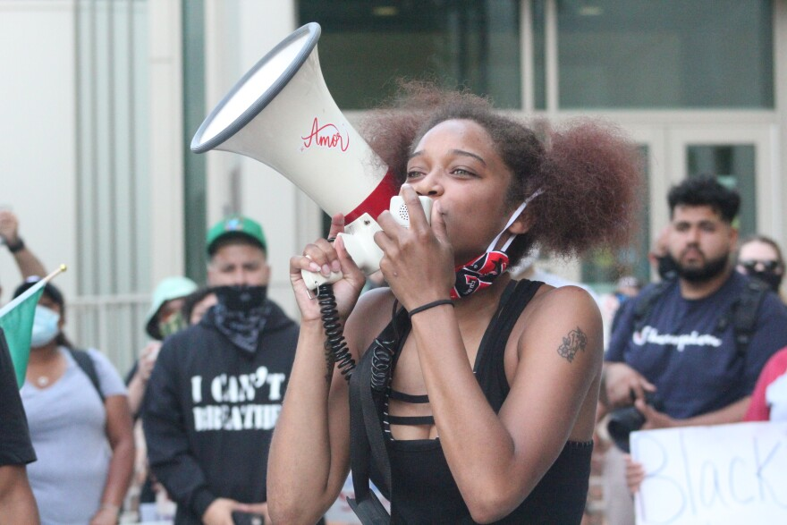 Lexi Qaiyyim was one of the event's organizers. She spoke to demonstrators in front of the San Antonio Police headquarters early in the protest.
