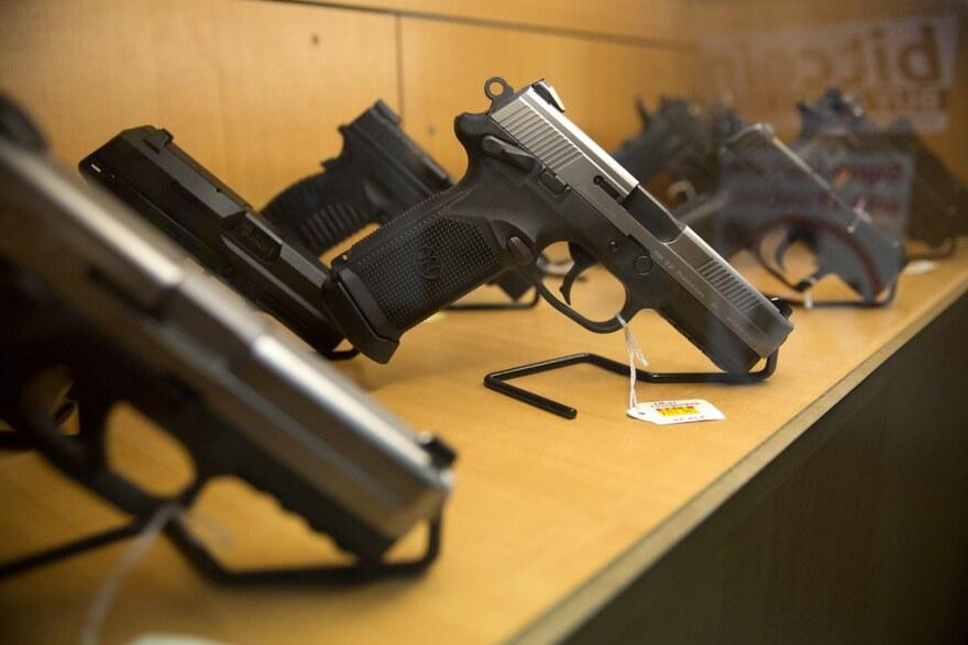 Guns on a shelf at a store