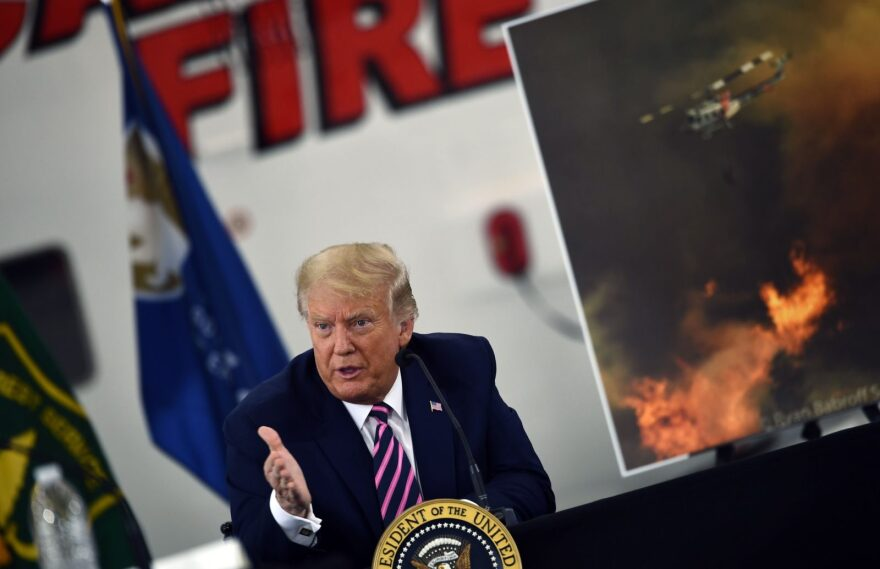 US President Donald Trump speaks during a briefing on wildfires with local and federal fire and emergency officials at Sacramento McClellan Airport in McClellan Park, California.