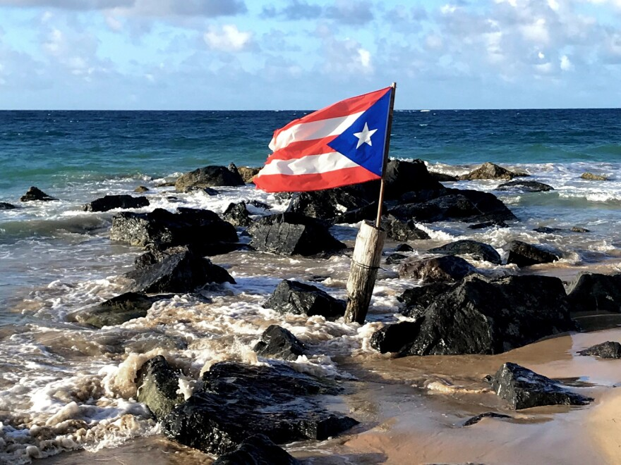 The Puerto Rico flag flies on the beach in Condado, a neighborhood of San Juan.