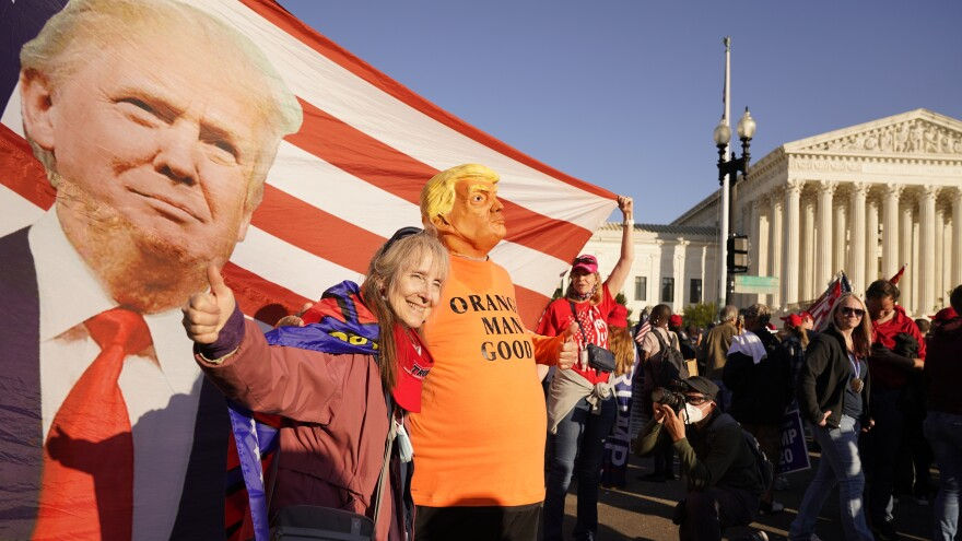 Supporters of President Trump attend pro-Trump marches outside the Supreme Court building in Washington on Nov. 14. The Trump team was dealt several losses in multiple courts Friday.