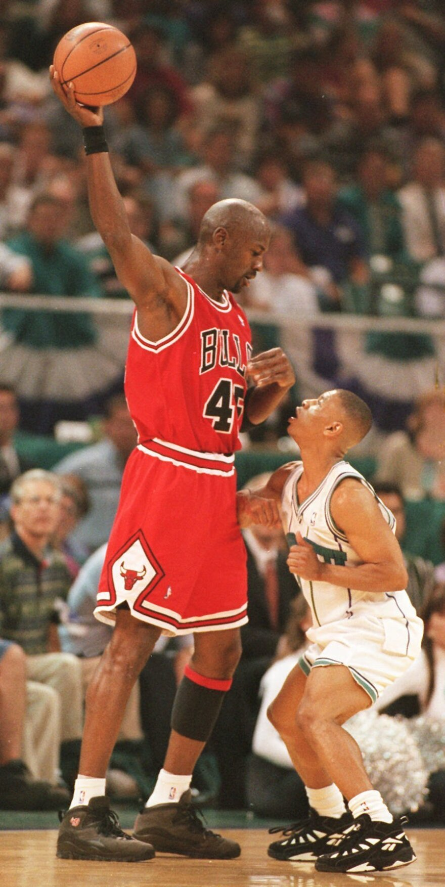 Chicago Bulls' Michael Jordan looks down on Muggsy Bogues during a game in 1995. Bogues, who stands 5 feet, 3 inches, is the shortest player in NBA history.