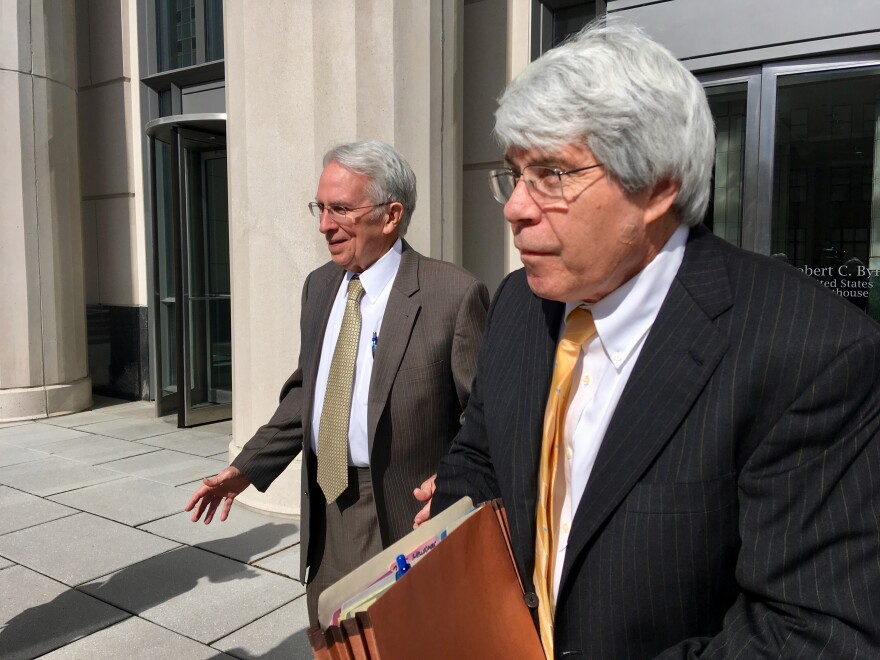 Former West Virginia Supreme Court Justice Menis Ketchum, left, leaves federal court with his attorney, Jim Calle, Wednesday, March 6, 2019, in Charleston, W.Va.