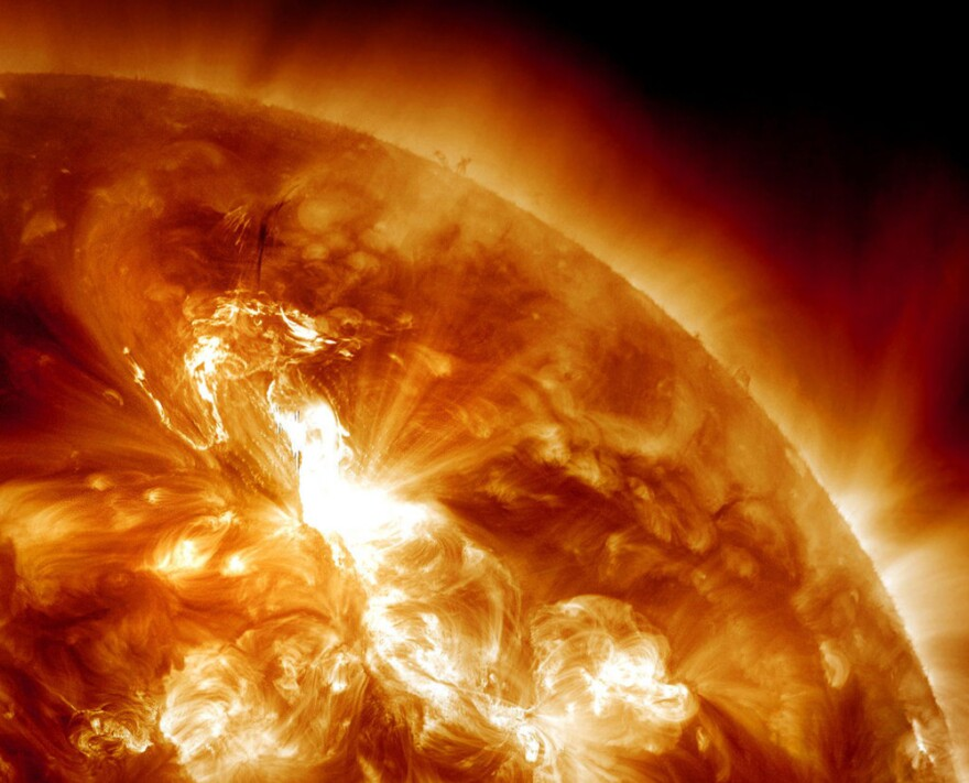 This January 23, 2012 image provided by NASA, captured by the Solar Dynamics Observatory, shows an M9-class solar flare erupting on the Sun's northeastern hemisphere.