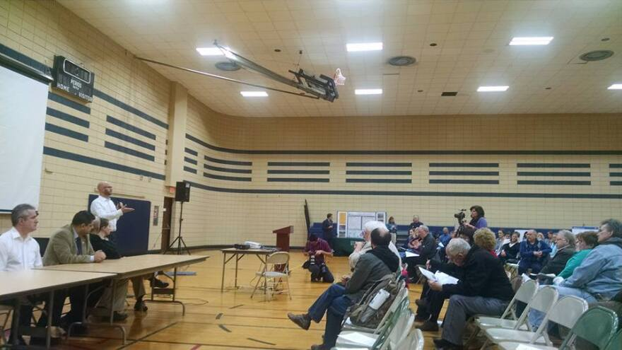 Health physicist for the Army Corps of Engineers Jon Rankins discusses updates to FUSRAP's remediation projects with a crowd at the James J. Eagen Civic Center in Florissant.