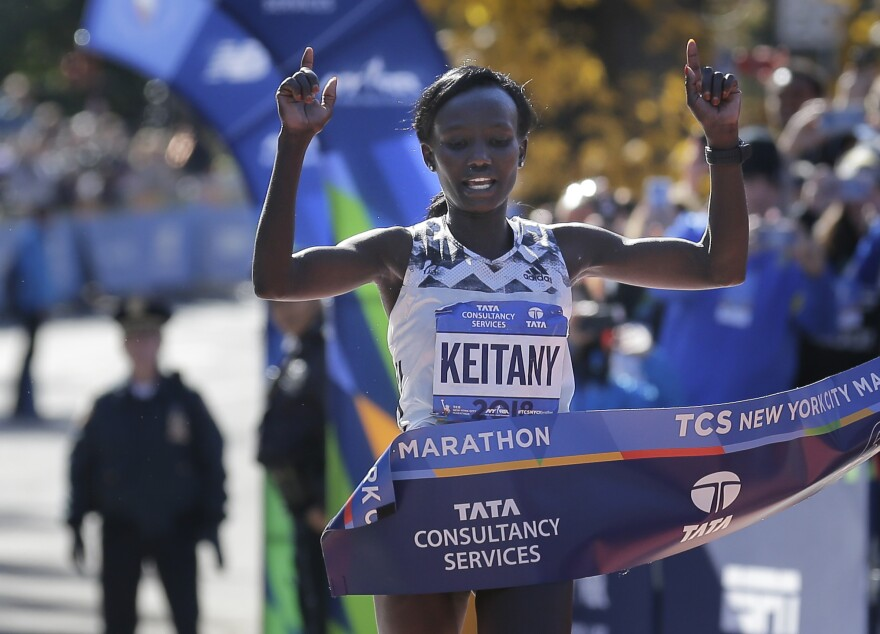Mary Keitany of Kenya is first to finish the women's NYC Marathon.
