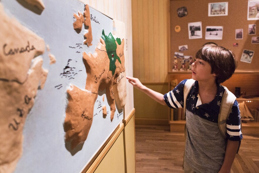 Aiden Hunter, 9, looks at a map of Europe to learn more about where the Holocaust took place. The children's exhibit at the United States Holocaust Memorial Museum in Washington, D.C., uses the fictional story of a boy named Daniel to teach children about the Holocaust.