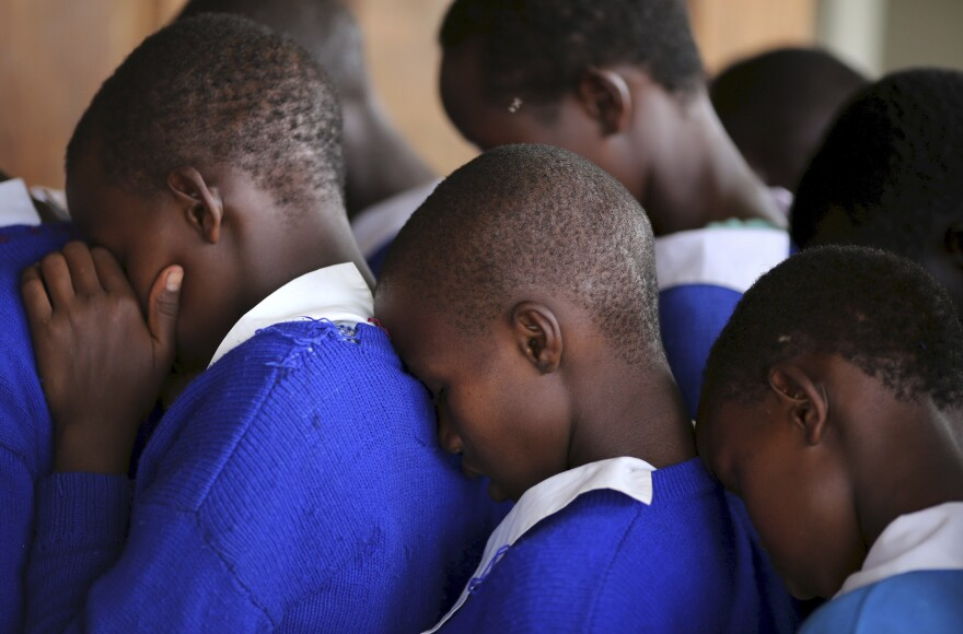 Students rehearse a poem that they will recite at an event advocating against female genital mutilation at the Imbirikani Girls High School in Imbirikani, Kenya.