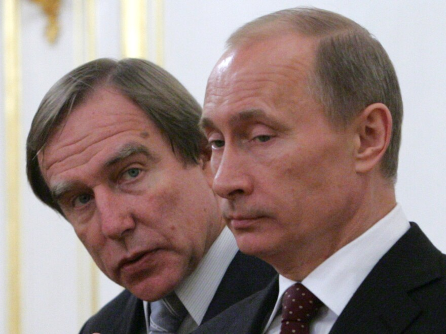 Cellist, conductor — and alleged billionaire — Sergei Roldugin (left) with Vladimir Putin at Russia's St. Petersburg Music House in 2009.