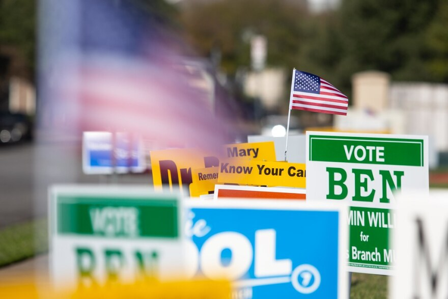 A bunch of campaign signs on Election Day.