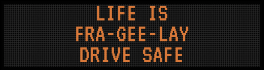 """Photo of a road sign with a christmas story reference on it, reading """"Life is fra-gee-lay, drive safe."""""""