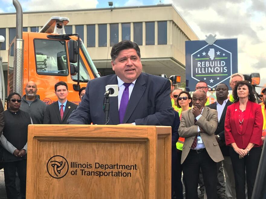 Flanked by Illinois Department of Transportation officials and state lawmakers, Illinois Gov. J.B. Pritzker announces details of statewide road and bridge construction at IDOT Headquarters in Springfield on Monday. 10/21/19