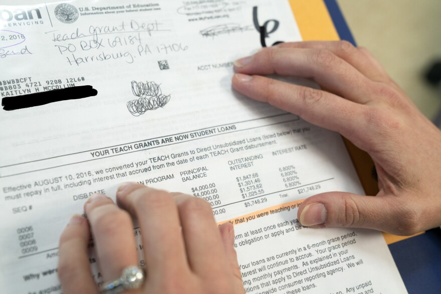 Kaitlin Huckaby McCollum points to documents that indicate a huge mishap concerning a $5k federal grant that unexpectedly, converted her TEACH grant into a loan. It began accruing interest immediately.