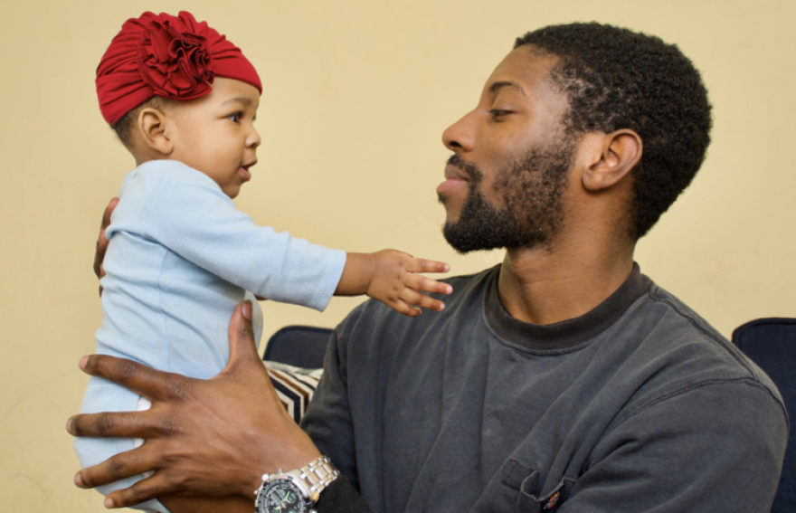 Trevon Robinson, 25, photographed Jan. 11, 2021 with his 6 month old daughter Zaria, is a recent graduate of the Fathers & Families Support Center