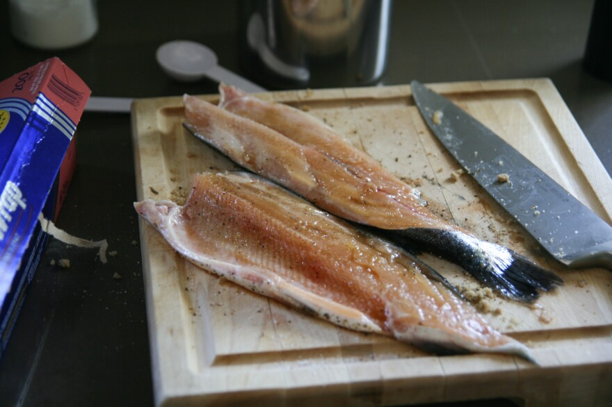Once you have the fillets, rub the fleshy side of the fish with 1 tablespoon of the sugar and the salt and pepper. Set aside for 10 minutes.