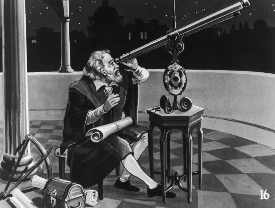 Italian astronomer and physicist, Galileo Galilei (1564 - 1642) using a telescope, circa 1620.