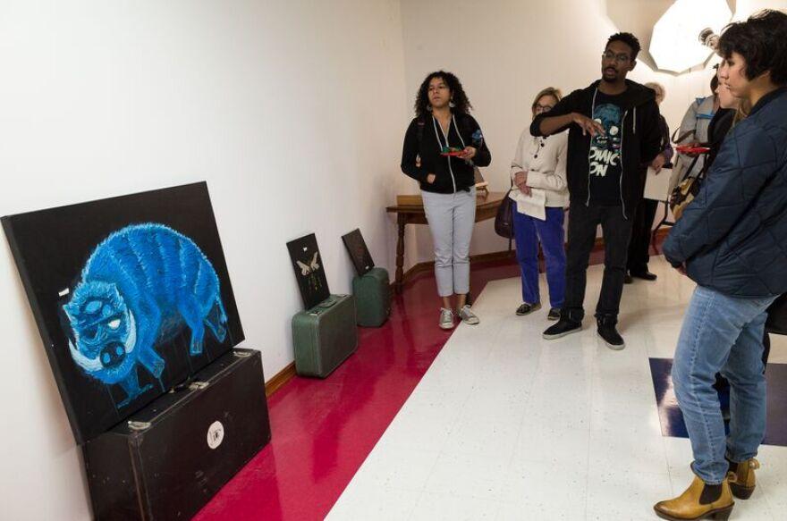 Artist Damon Davis talks with visitors at his photography studio.