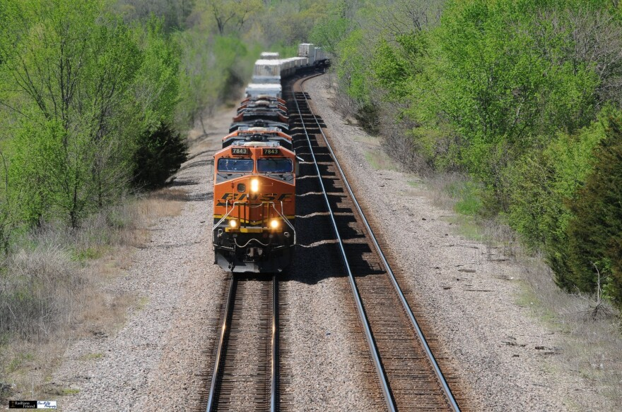 Bob Cox photographs a train while rail watching with his wife Amy above a bridge three miles northeast of La Plata Missouri.
