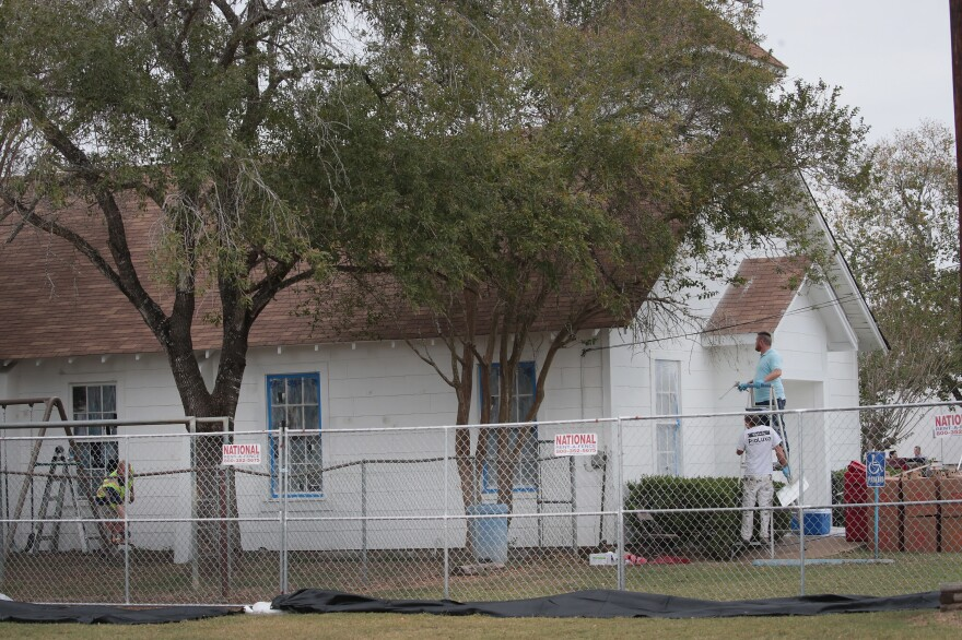 Workers patch bullet holes and paint the exterior of the First Baptist Church in Sutherland Springs, Texas, on Thursday after a gunman opened fire Sunday, killing 26 people and wounding 20 others.