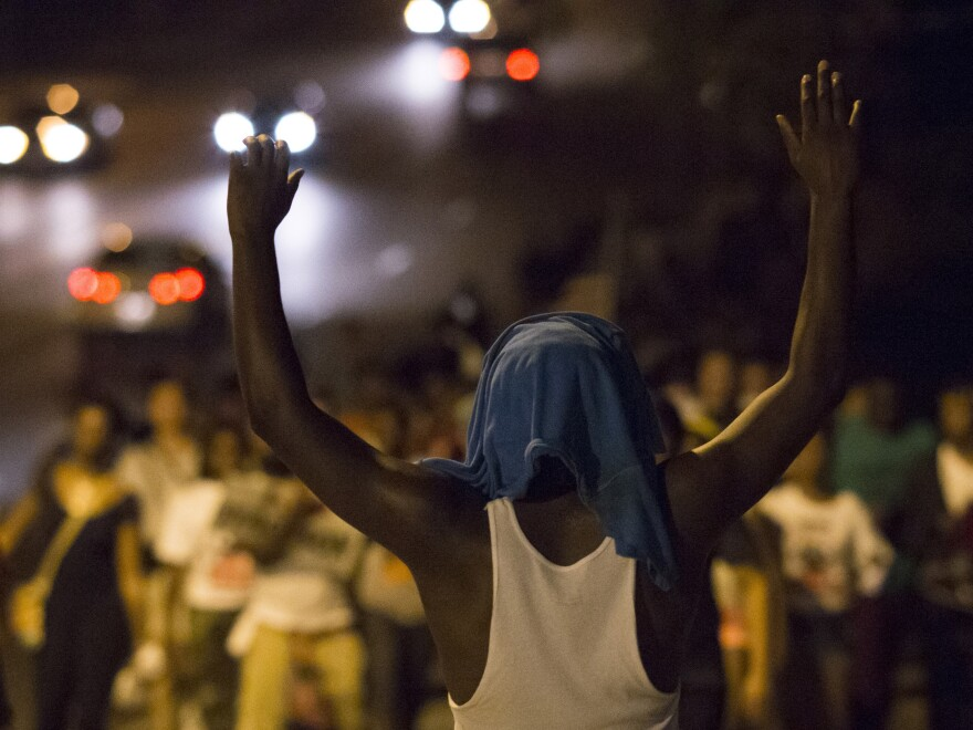 Demonstrators march towards the Ferguson Police Department on Friday to protest the killing of unarmed teen Michael Brown in Ferguson, Mo.
