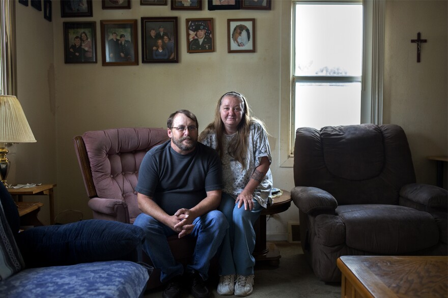 Doug Byrum poses for a portrait with his wife, Ruth Ann, at their Mitchell, Illinois, home on Nov. 7, 2016. Byrum is one of 2,000 U.S. Steel employees who has been without work for nearly a year.