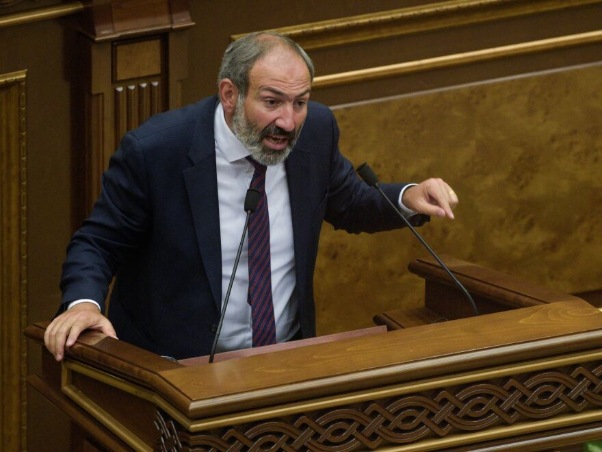 Nikol Pashinyan, the only candidate for prime minister, answers lawmakers' questions at the extraordinary session of parliament Tuesday. Lawmakers later rejected him, leaving the post vacant.