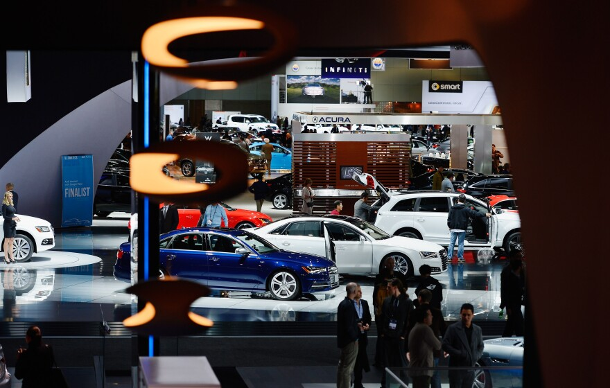 Attendees walk through the Los Angeles Convention Center floor during the L.A. Auto show on Nov. 29. Technology is taking the idea of working from the road to a whole new level.