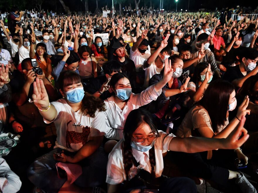 Protesters flash <em>The Hunger Games</em> salute during a pro-democracy rally at Thammasat University in Pathum Thani, north of Bangkok, earlier this month.