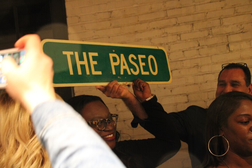 alissia_canady_holding_a_paseo_sign_at_party.jpg