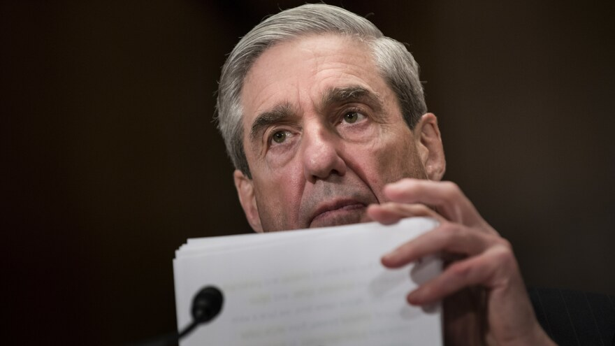 Robert Mueller testifies before Congress in 2013. A redacted version of Mueller's report as special counsel was released on Thursday.