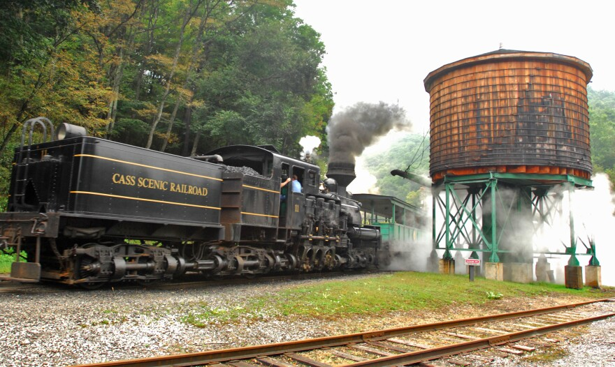 A passenger train from the Cass Scenic Railroad passes the water tower Friday, Sept. 14, 2007, in Cass, W.Va.