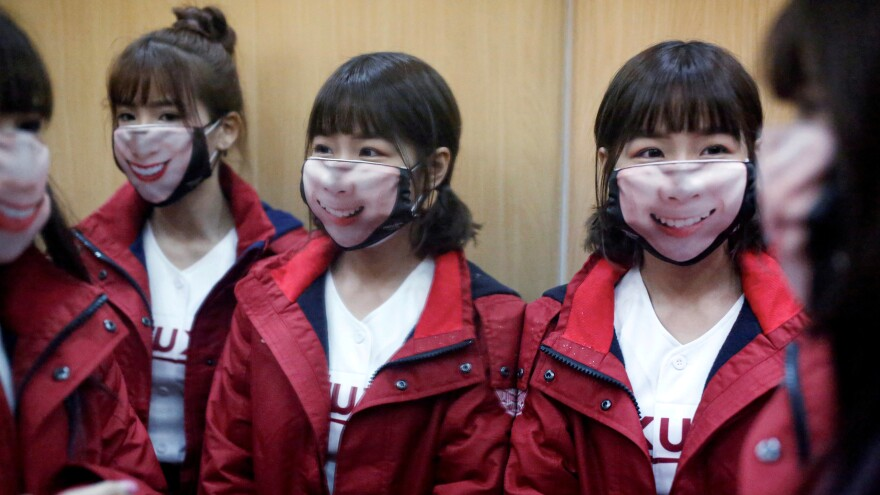 Cheerleaders wore face masks as Taiwan recently prepared for the the first professional baseball league game of the season. The island has emerged as a success story in containing coronavirus, avoiding the need for a strict lockdown.