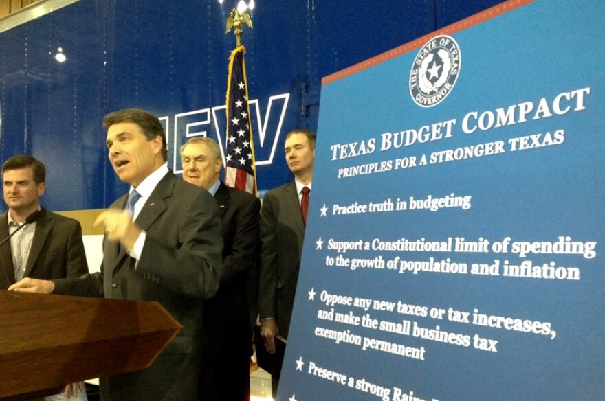 """Gov. Rick Perry unveils his """"Texas Budget Compact"""" in Houston on Monday, April 16. On stage with Perry, from left to right: state Reps. Brandon Creighton, R-Conroe, and Wayne Smith, R-Baytown, and conservative activist Michael Quinn Sullivan."""