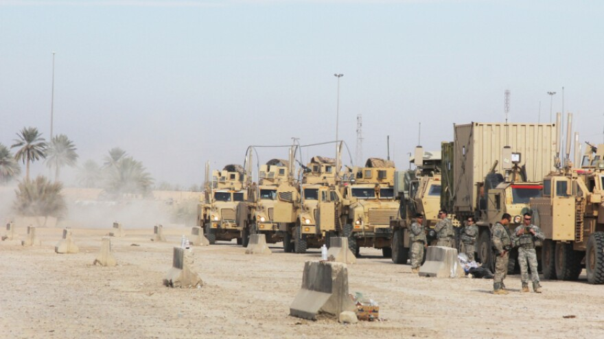 A convoy of soldiers from the 82nd Airborne line up at Contingency Operating Station Kalsu, a U.S. base about 60 miles south of Baghdad. For many U.S. troops, it is the last stop in Iraq on the way out of the country.