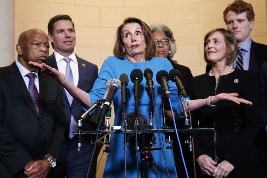 House Minority Leader Nancy Pelosi, D-Calif., joined by from left, Rep. John Lewis, D-Ga., Rep. Eric Swalwell, D-Calif., Rep. Joyce Beatty, D-Ohio., Rep. Kathy Castor, D-Fla., and Rep. Joe Kennedy, D-Mass., gestures as she speaks to media at Longworth House Office Building on Capitol Hill in Washington, Wednesday, Nov. 28, 2018, to announce her nomination by House Democrats to lead them in the new Congress. (Carolyn Kaster/AP)