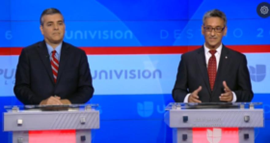 Florida state Representative Robert Asencio (right) debating his 2016 opponent David Rivera.