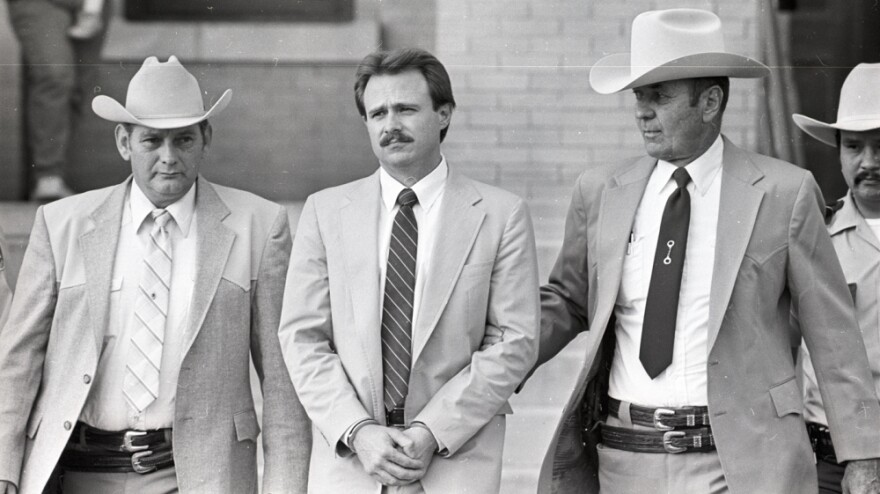 Michael Morton is taken back to jail in February 1987 by Sgt. Don Wood (left) and Sheriff Jim Boutwell (right) after he was convicted of his wife's murder.