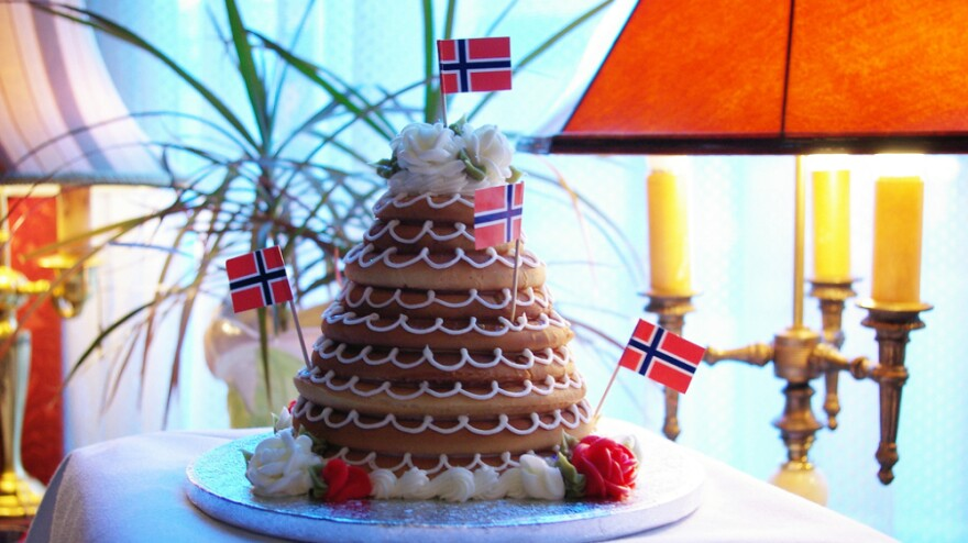 In Denmark they eat a towering cake called <em>kransekage</em> for New Year's Eve. Norwegians, who also eat it, call it <em>kransekake.</em>