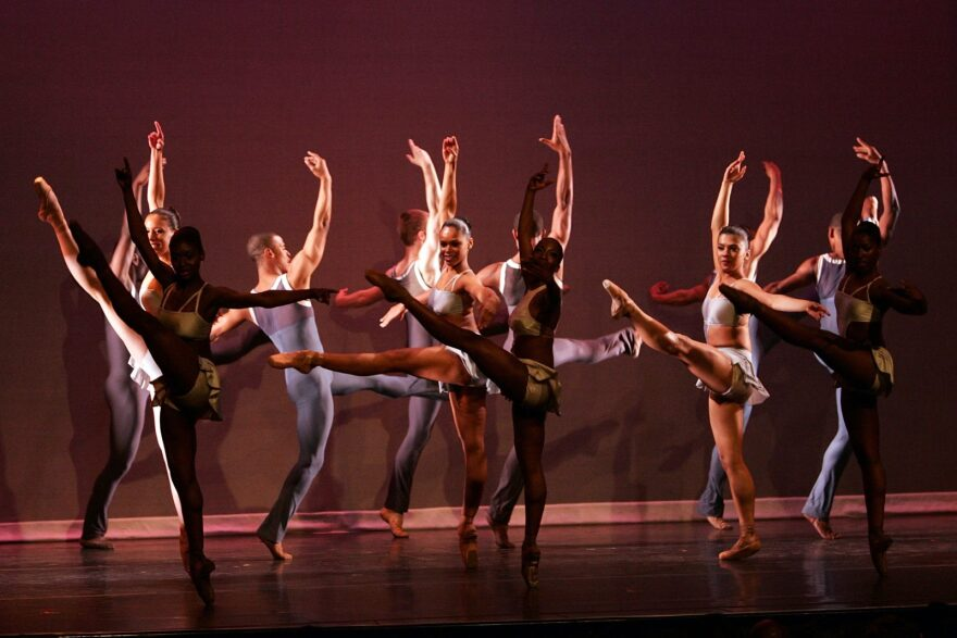 Members of the Dance Theatre of Harlem perform onstage at the Apollo Theater in New York City.