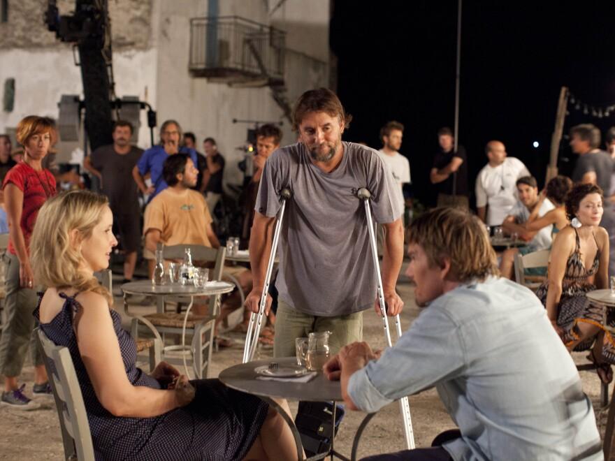 Richard Linklater (center) directs Julie Delpy and Ethan Hawke on the set of <em>Before Midnight</em>.