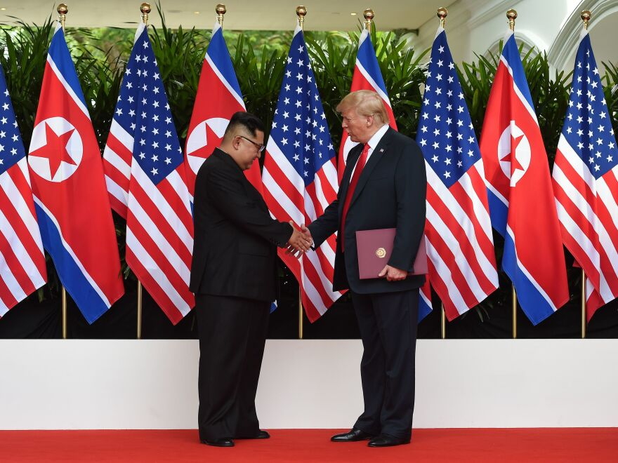 North Korea's leader Kim Jong Un shakes hands with President Trump after taking part in a signing ceremony at the end of their historic U.S.-North Korea summit at the Capella Hotel on Sentosa island in Singapore on June 12, 2018.