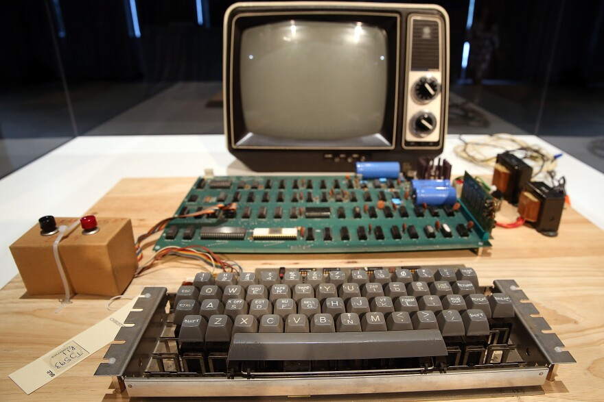 An Apple I computer, built in 1976, is displayed during the First Bytes: Iconic Technology From the Twentieth Century, an online auction featuring vintage tech products at the Computer History Museum in 2013 in Mountain View, Calif.